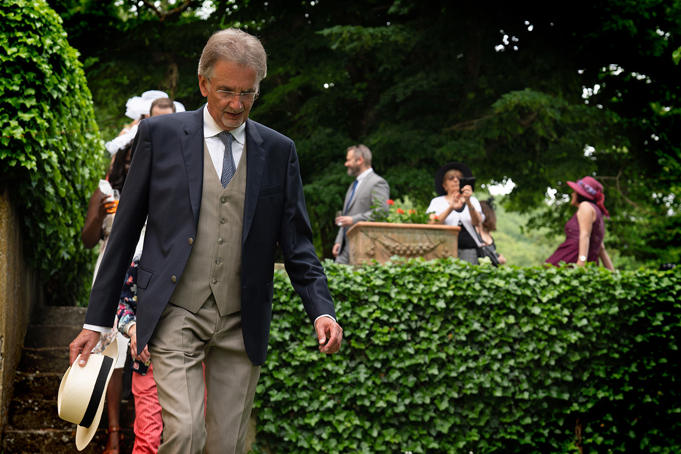 Same-Sex Wedding Photographer Florence: Timur & Guillaume. Guests walking toward the ceremony area