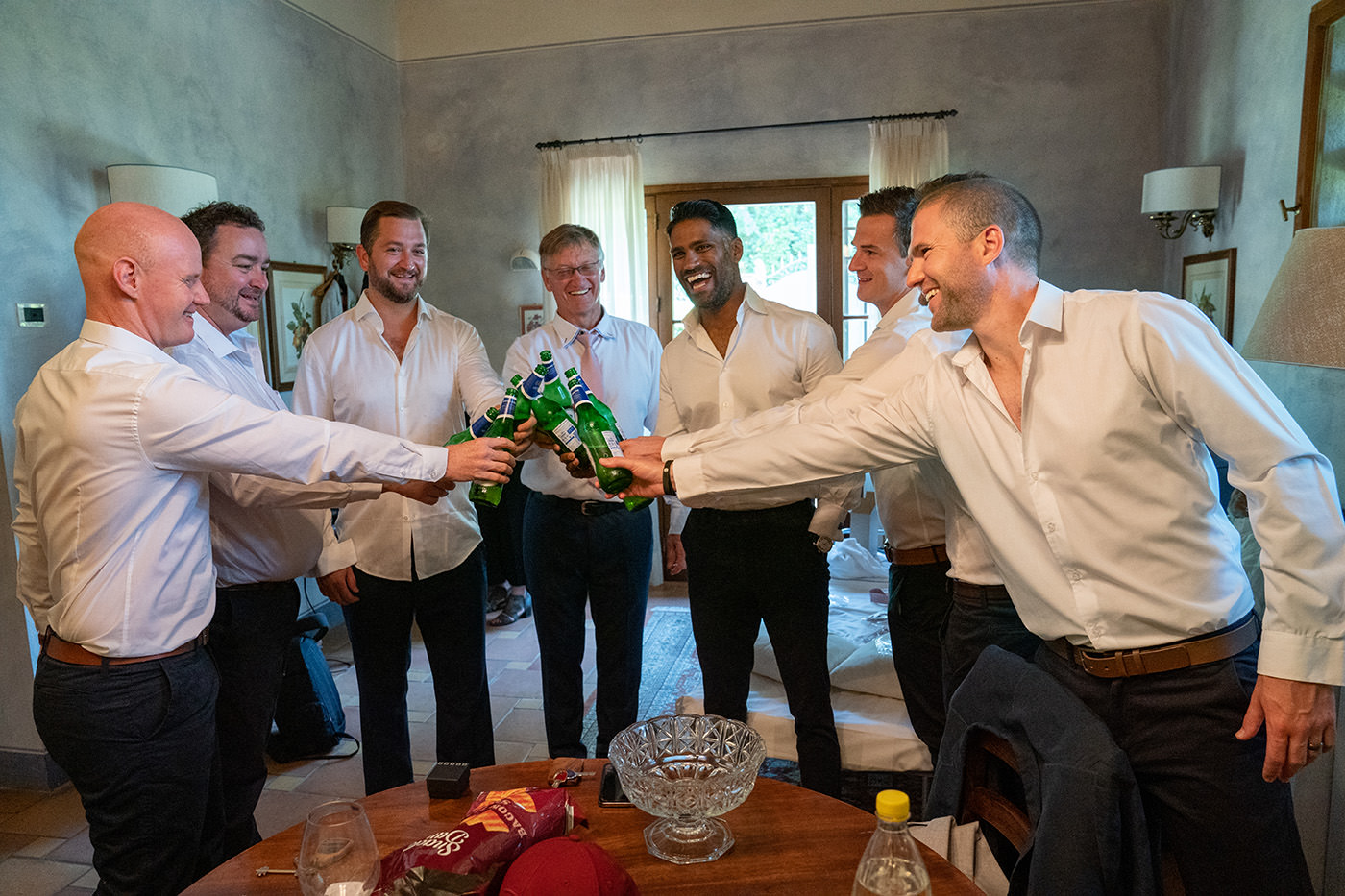 Tuscan Wedding Photo Shoots At Palagio Castle: groomsmen make a toast