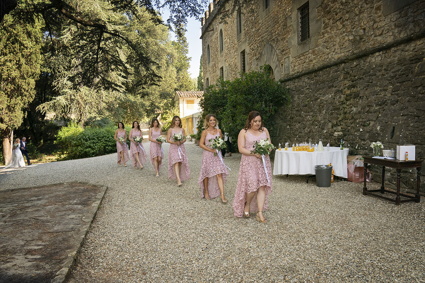 Duccio Argentini: Tuscan Wedding Photo Shoots At Palagio Castle. Bridesmades walking toward the ceremony
